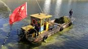 早上看见黄山新安江上的柴油船插着国旗,这是环卫船哦!