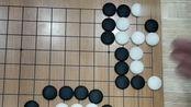 围棋精彩残局:黑棋在这种棋形要用扑的方法,白棋就死了,厉害!